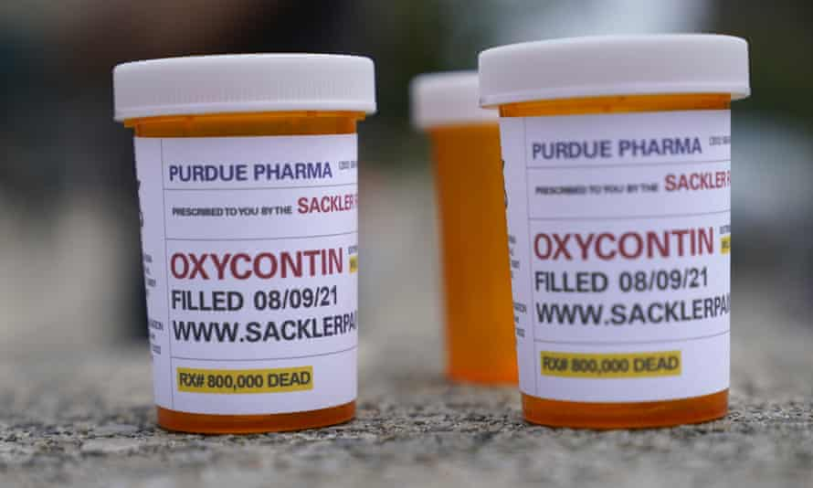 Fake pill bottles with messages about Purdue Pharma are displayed during a protest outside a courthouse in White Plains, New York, on 9 August.
