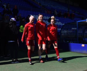 Ashley Hodson, Niamh Charles and Laura Coombs of Liverpool walk out.
