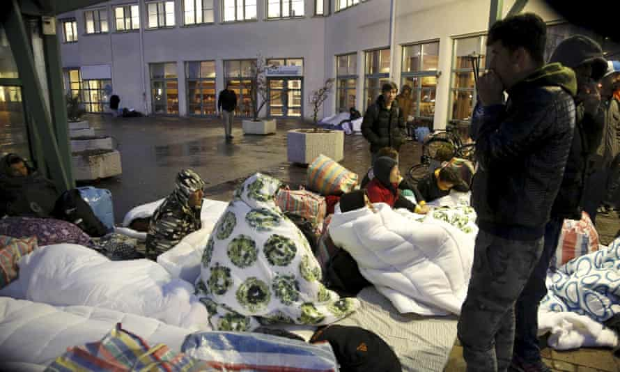 Refugees outside the entrance to the Swedish Migration Agency's arrival centre in Malmö.