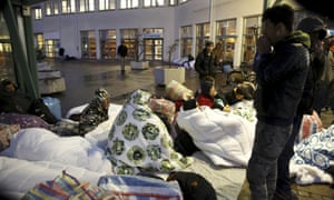 Refugees sleep outside the Swedish Migration Agency's arrival centre in Malmo. Sweden is reported to be conisidering deporting as many as 80,000 asylum seekers.