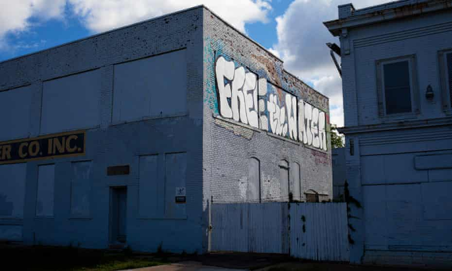 """A mural painted by Antonio Cosme, one of two Detroit artists who went to trial for painting """"Free the Water"""" on one of Detroit's water towers."""
