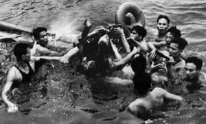A photograph released on February 24 2000, by the Vietnamese News Agency claims to show the rescue of U.S. pilot John McCain, center, from Hanoi's Truc Bach lake in 1967.