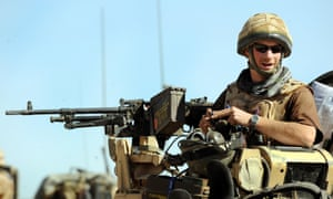 Prince Harry sitting in his position on a Spartan armoured vehicle in Helmand province, Southern Afghanistan.