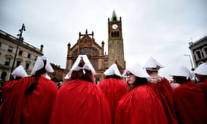 Pro-choice supporters wear handmaiden robes at a protest against abortion laws in Derry, Northern Ireland.