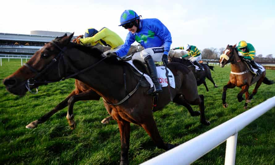 Hurricane Fly picture in typical battling mode when winning the Irish Champion Hurdle in 2014.