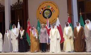 Theresa May poses with Gulf Cooperation Council leaders for a group picture.