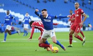 Liverpool's Neco Williams brings down Brighton's Aaron Connolly in the box.