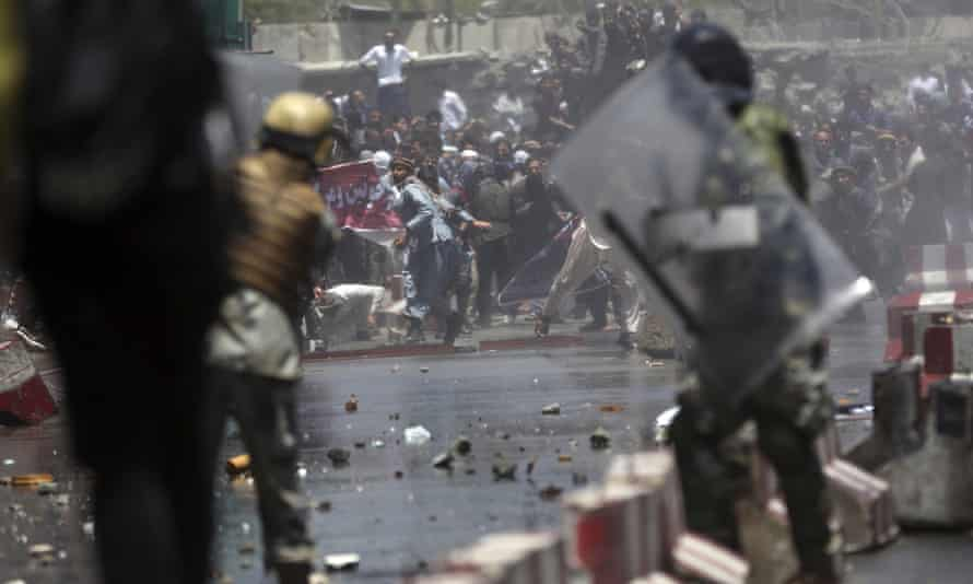 Protesters throw stones at security officials in Afghanistan