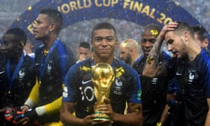 Kylian Mbappé, one of the stars of the tournament, lifts the trophy