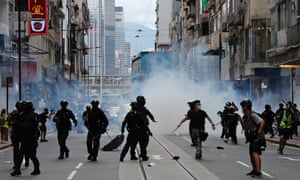 Riot police fire tear gas to disperse anti-national security law protesters.