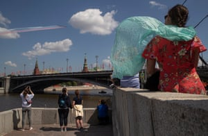 People watch a flypast above the Kremlin