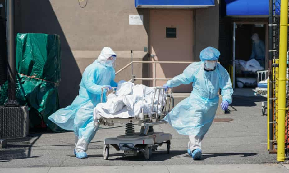 Bodies are moved to a refrigeration truck serving as a temporary morgue at Wyckoff hospital in Brooklyn on 6 April 2020 in New York.