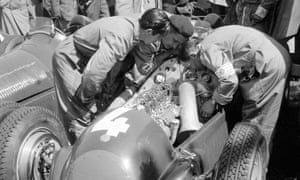 Mechanics inspect the Alfa Romeo 158 driven to third place by Britain's Reg Parnell.