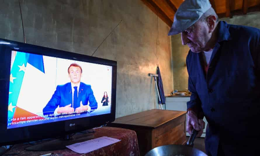 Retired farmer Henri Boutfol watches French President Emmanuel Macron's televised speech on March 31, 2021, Chartres, eastern France.