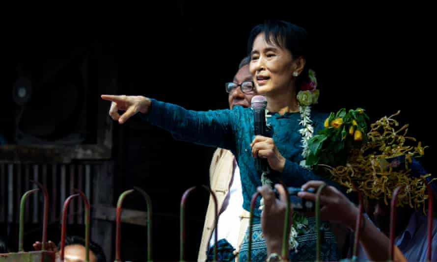 Aung San Suu Kyi addresses thousands of her supporters in 2010 from the gates of her villa, the site of her house arrest in Myanmar.