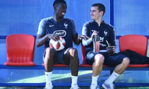 Pogba shares a joke with  Antoine Griezmann during a break in training