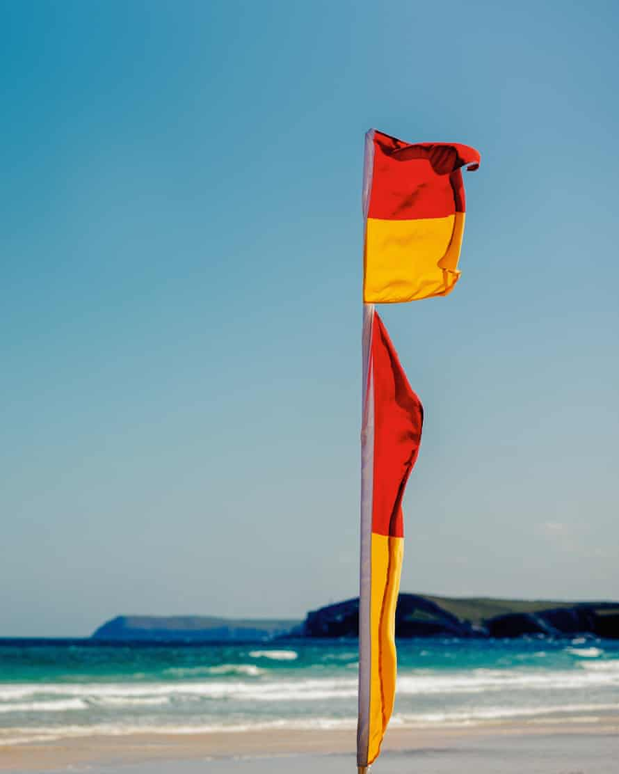 A flag indicating the safe zone on the beach
