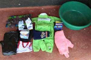 Her hospital bag contains: – baby blanket– cotton wool– chitenge– babygrow – napkins– bowl– polythene roll