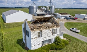 'Grain bins were crumpled like aluminum foil. Three hundred thousand people remained without power in Iowa and Illinois on Friday.'