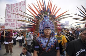 A supporter of the Bears Ears and Grand Staircase-Escalante national monuments wears a headdress at a rally in Salt Lake City, US