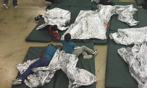 In a photo provided by US Customs and Border Protection, children rest in one of the cages at a facility in McAllen, Texas.