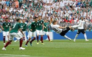 Germany's Joshua Kimmich ties an acrobatic effort.