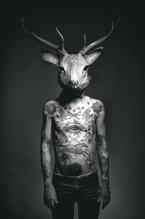Tattooed man with stag's head, by Liam Sparkes.