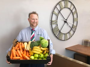 Graham Blaikie holding a box of fruit and vegetables