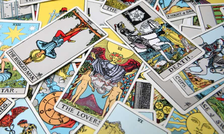 Tarot cards featuring the Hanged Man and Death and the Lovers.