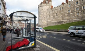 A person sleeps rough in a bus shelter outside Windsor Castle earlier this month.