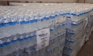 Red Cross volunteers have been handing out cases of bottled water to anyone in need.