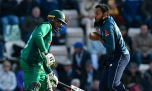 Adil Rashid of England takes the wicket of Babar Azam of Pakistan caught and bowled .