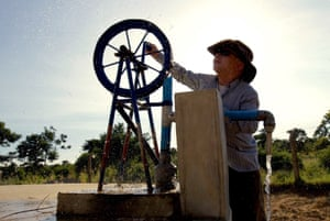 A local man collects water from the Umoja Training Centre, built in 2013 by Standing Voice.