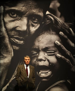Don McCullin poses next to 'A woman and child waiting for medical attention' taken by him in Bangladesh in 1971.