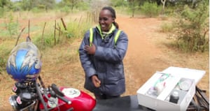 A Christian Aid Healthworker with her motorbike