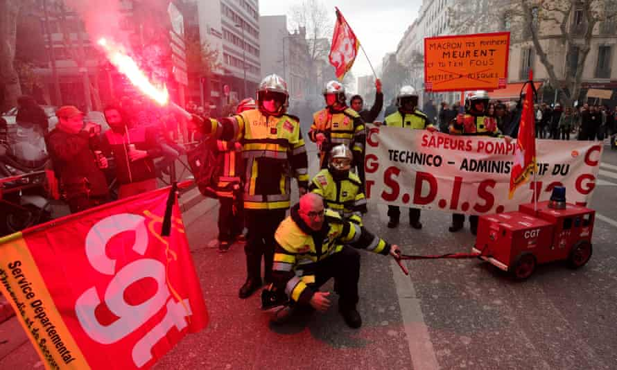French firefighters take part in a demonstration against pension reforms in Marseille on Thursday.
