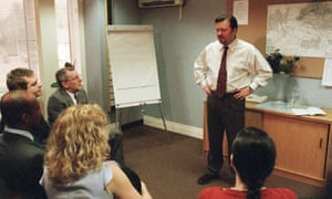 A scene from the television show The Office with manager David Brent (Ricky Gervais) holding a training talk