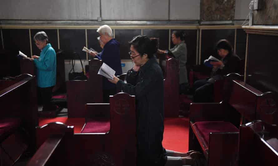 Catholic worshippers attend a mass at the government-sanctioned South Cathedral in Beijing