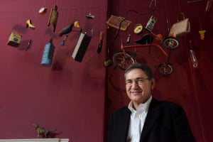 Orhan Pamuk amid objects from his Museum of Innocence show at Somerset House, London.