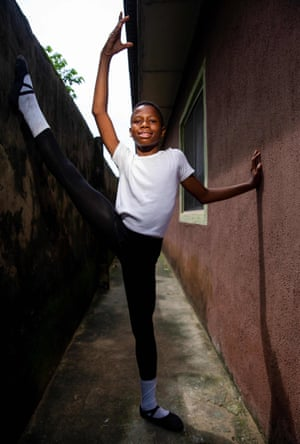 Student Anthony Madu performs a ballet pose in Okelola street. The lessons are free and shoes and kit provided to the children