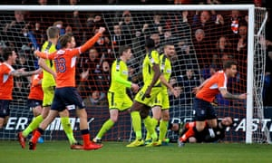 Luton Town defender Johnny Mullins, right, celebrates after scoring.