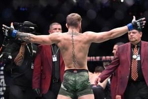 Conor McGregor gestures at Khabib Nurmagomedov before their bout.