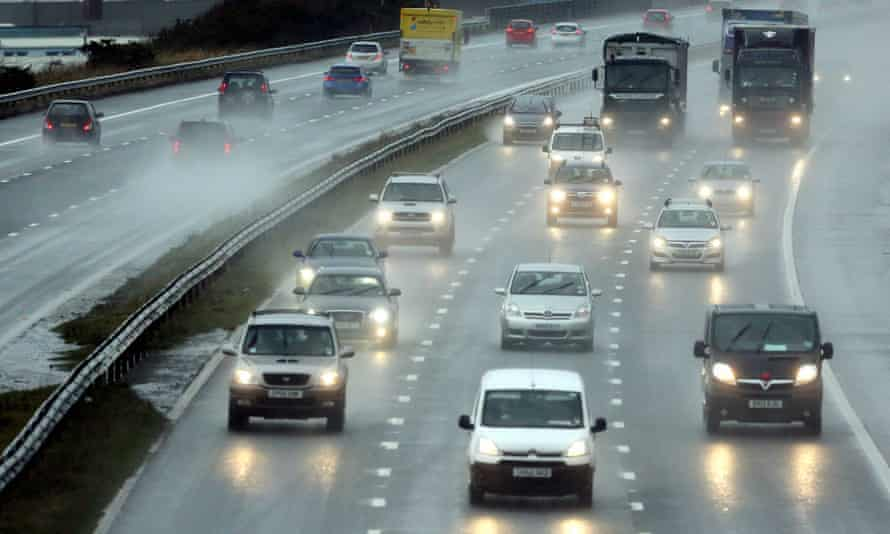 Poor driving conditions with rain and spray on the M4 motorway