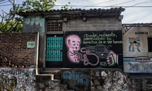 A pro-life mural showing a gun pointed at a foetus