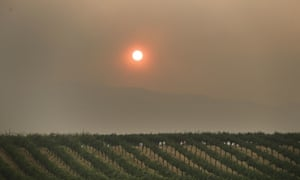 Smoke from a wildfire in northern California turns the setting sun red.