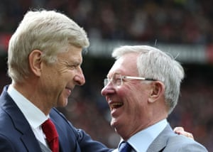 Sir Alex Ferguson greets Arsene Wenger tp present a retirment gift before kick off at Old Trafford.