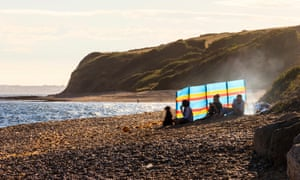 Family having an evening barbecue on the beach, Ringstead Bay, Dorset