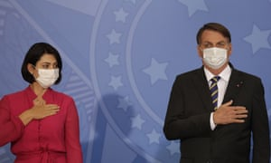 President Bolsonaro's wife, Michelle, tested positive for coronavirus on Thursday. This photo was taken on Wednesday at an event at the presidential palace in Brasilia.