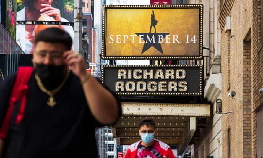 People walk past the Richard Rodgers theater where the musical Hamilton is normally performed