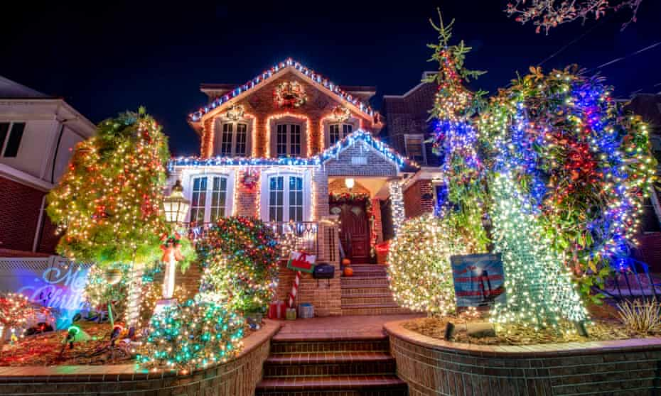 A house is decorated with lights in Dyker Heights on 11 December. 'It makes you feel like you're doing something to make everybody happy,' said Lucy Spata.